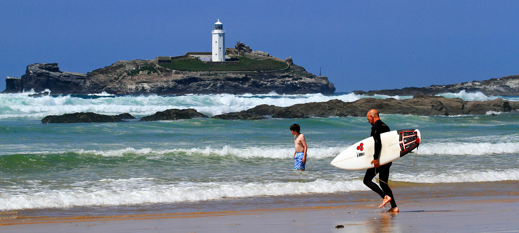 Surfers at Godrevy Beach near Hayle